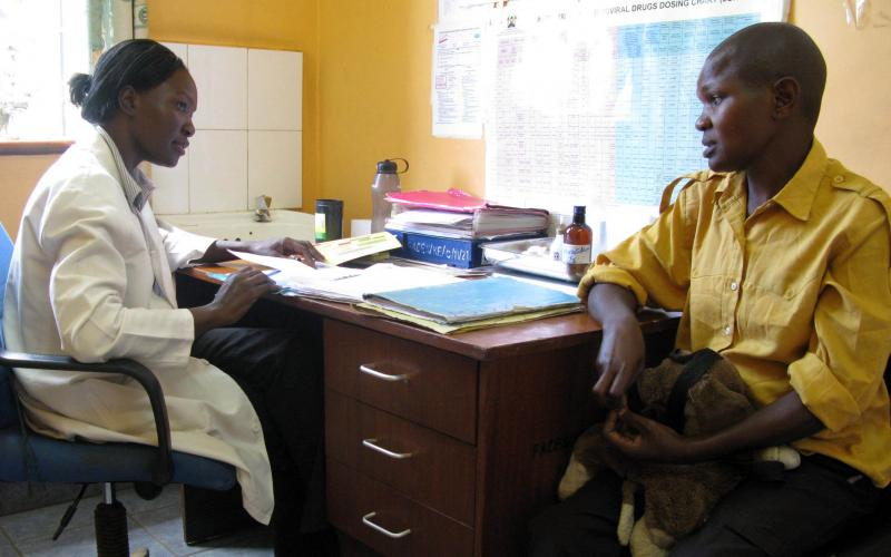 Photo of clinician and patient in consultation at FACES clinical site. Credit: Beth Novey